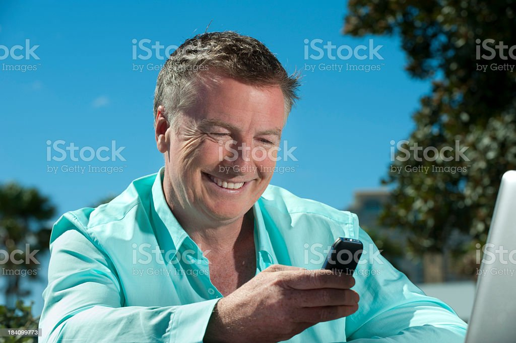 Mature Man texting royalty-free stock photo