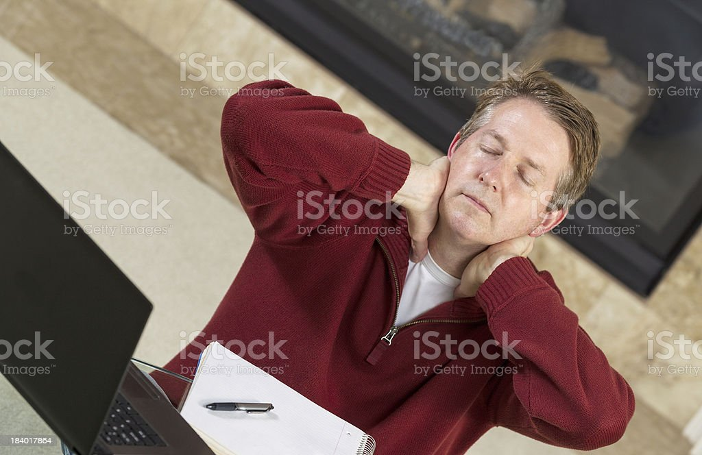 Mature man tired while working at home royalty-free stock photo