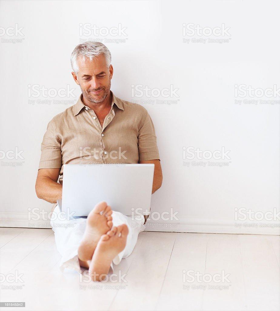 Mature man using a laptop stock photo