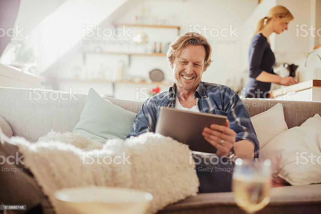 Mature man using digital tablet stock photo