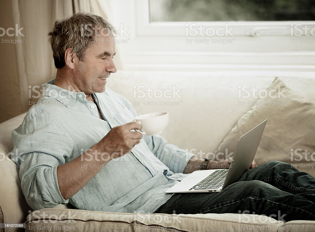 Mature man using laptop royalty-free stock photo