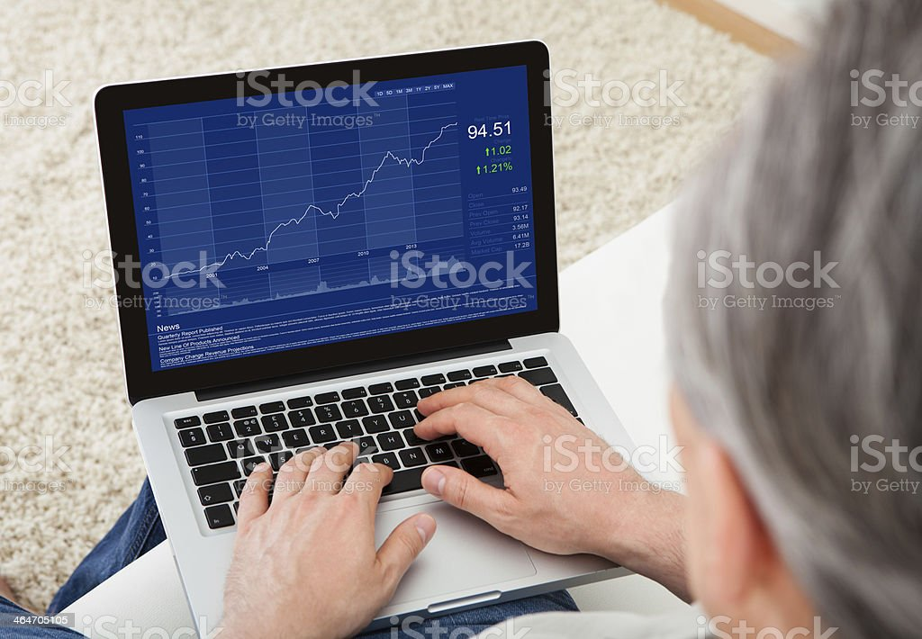Mature man using laptop stock photo