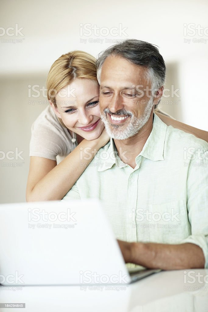 Mature man using laptop with woman royalty-free stock photo