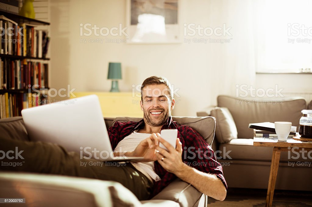 Mature man using smart phone stock photo
