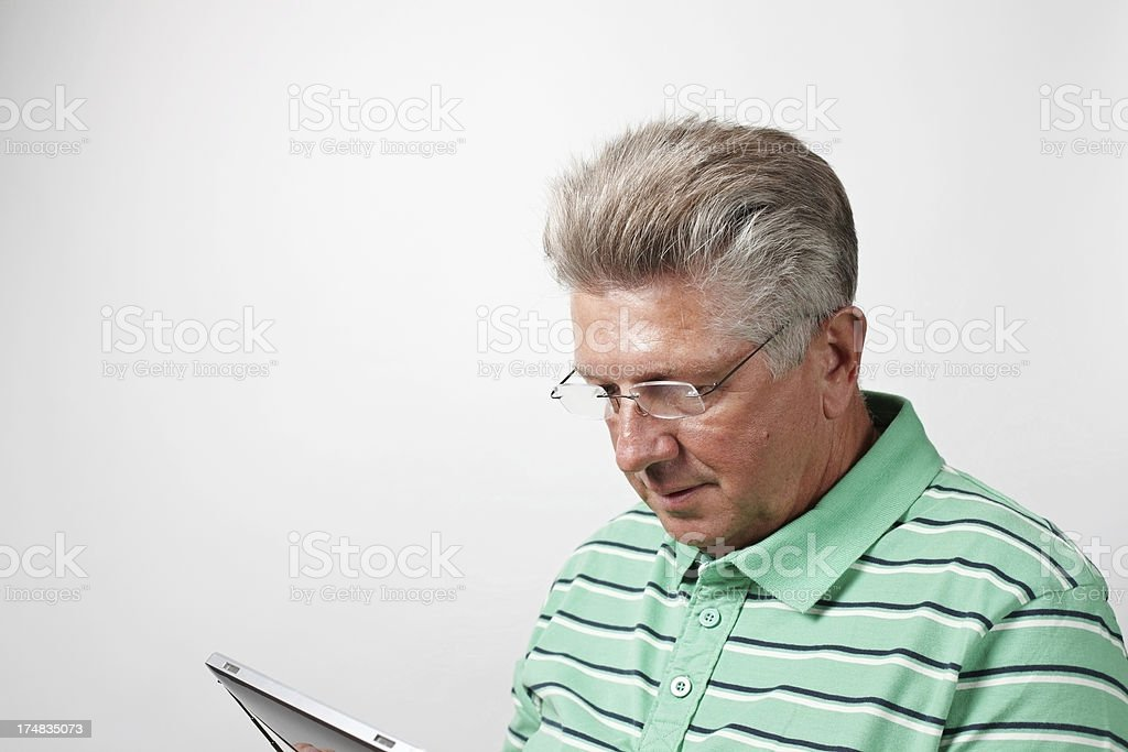 Mature man using tablet device royalty-free stock photo