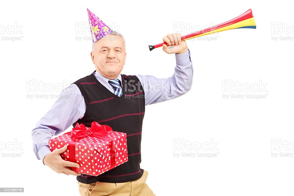 Mature man wearing a party hat and holding gift royalty-free stock photo