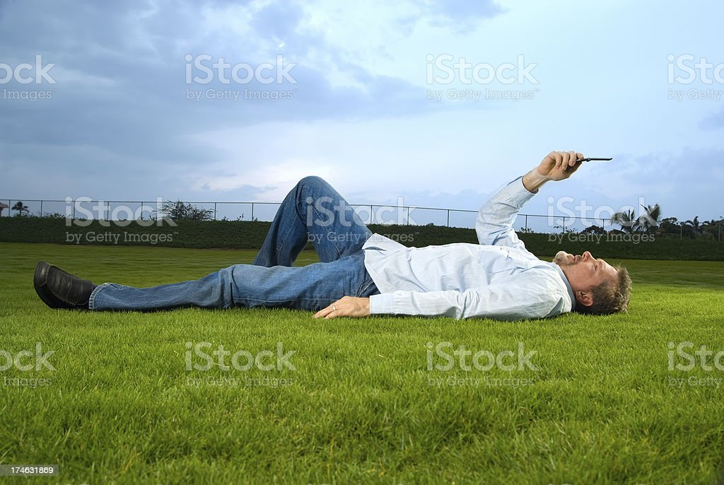 Mature man with a cell phone royalty-free stock photo
