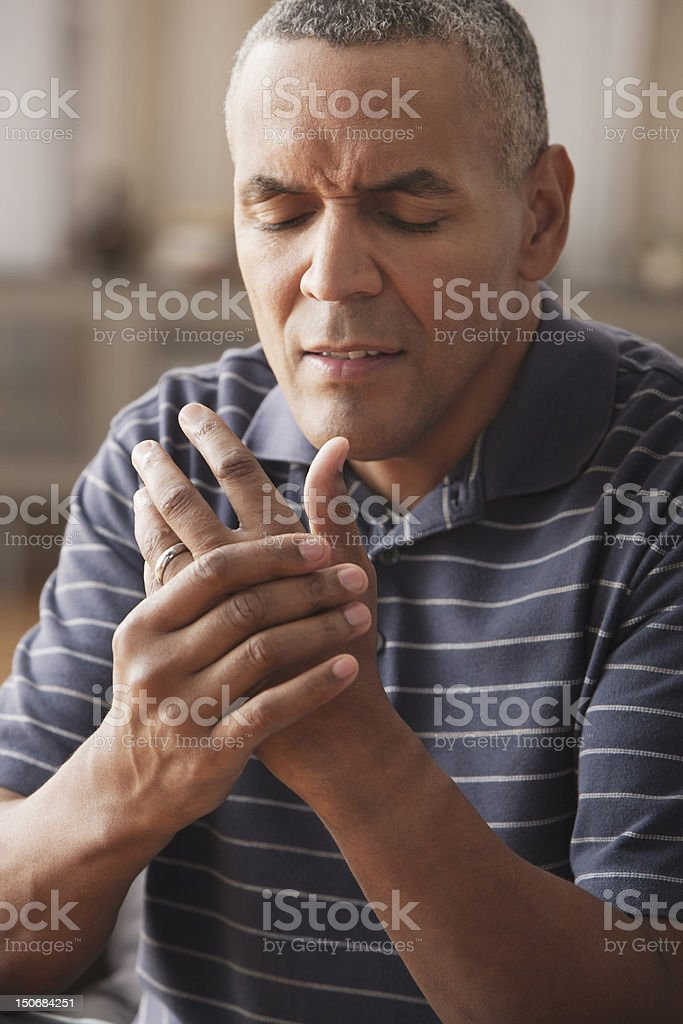 Mature man with arthritis pain stock photo