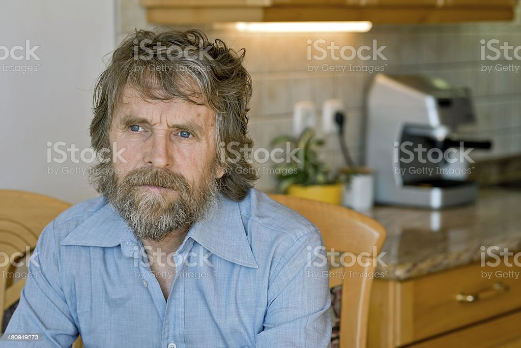 Mature Man with Beard in Domestic Kitchen, Europe stock photo