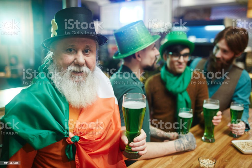 Mature man with beer stock photo