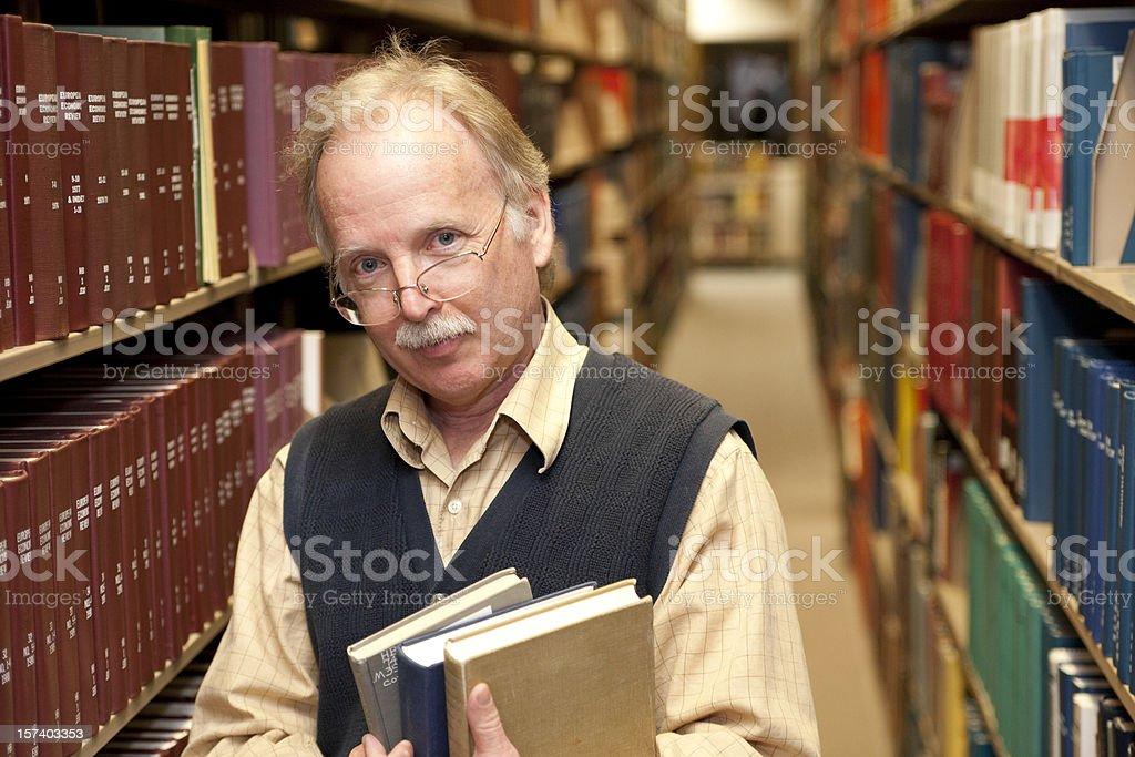 Mature man with books (XXL) royalty-free stock photo
