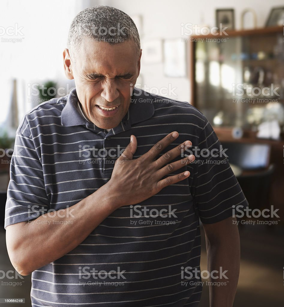 Mature man with chest pains stock photo