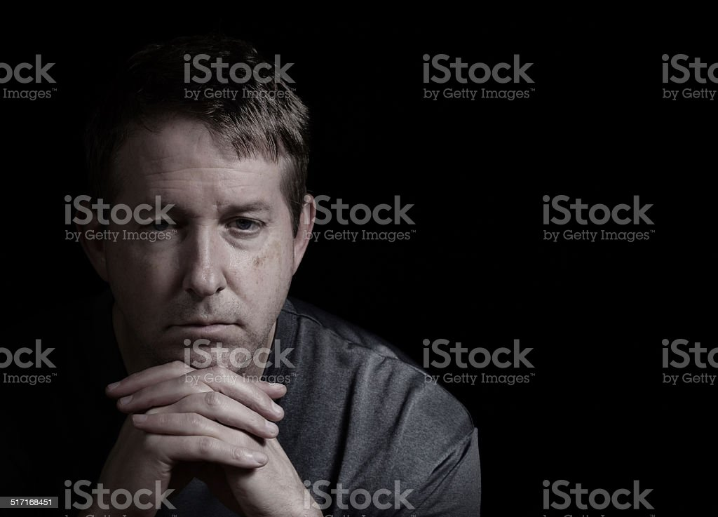 Mature man with depressed look stock photo