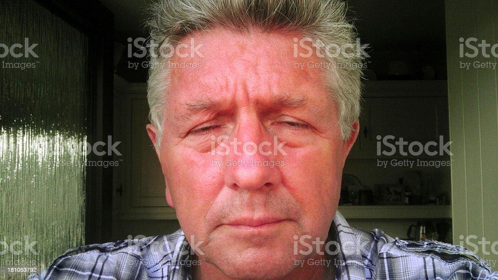 Mature man with headache pain royalty-free stock photo