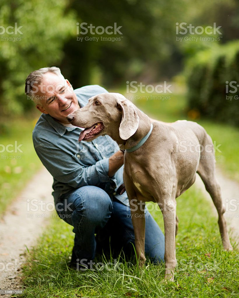 Mature Man With His Dog In Park. stock photo