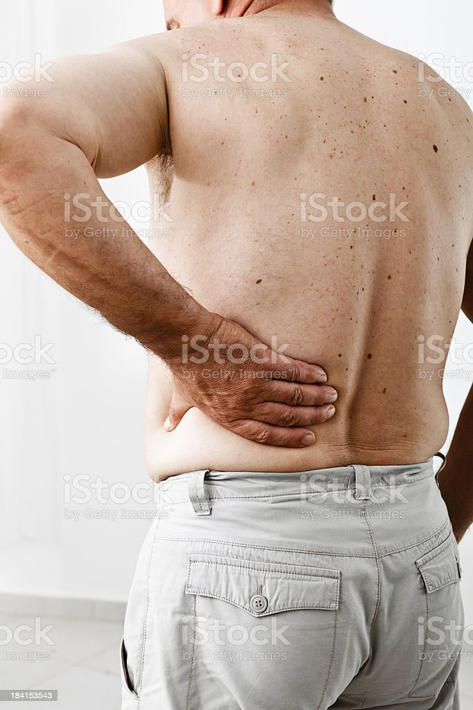 Mature Man with Lower Back Pain, Rear View royalty-free stock photo