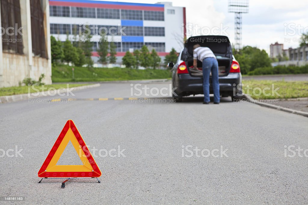 Mature man with open luggage rack of car royalty-free stock photo