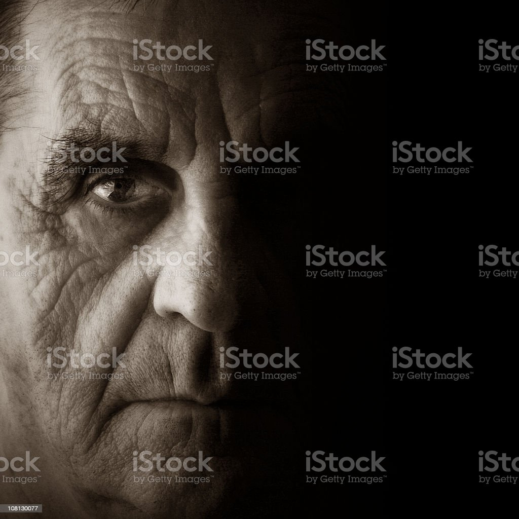 Mature man with serious facial expression royalty-free stock photo