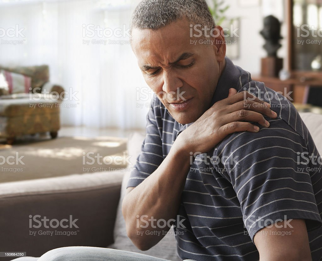 Mature man with shoulder pain stock photo