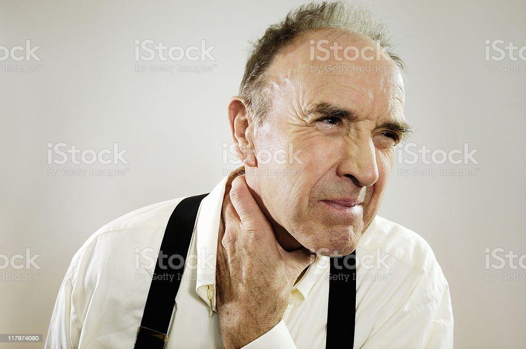 Mature man with sore throat stock photo