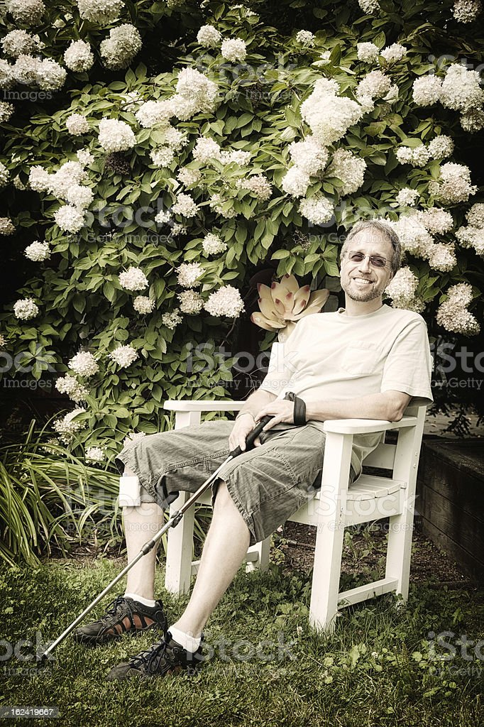 Mature man with MS taking a break stock photo