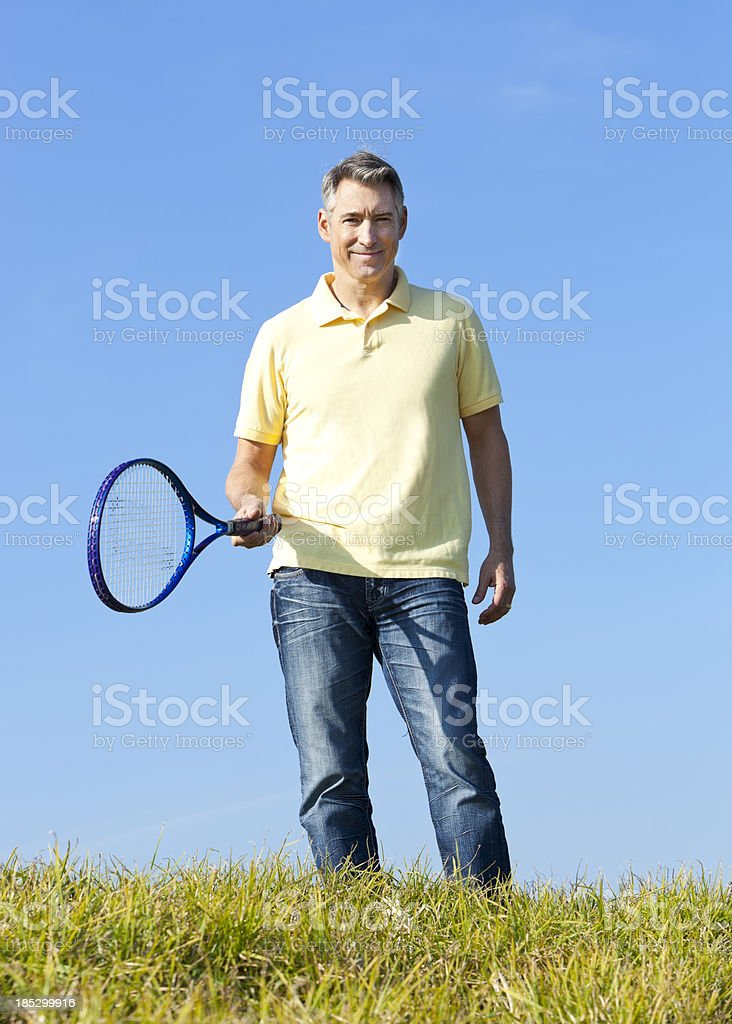 mature man with tennis racket royalty-free stock photo