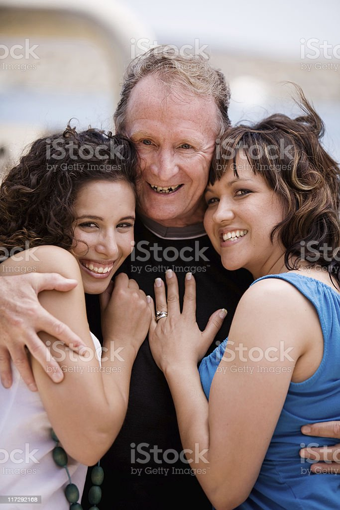 Mature Man with two Honeys stock photo