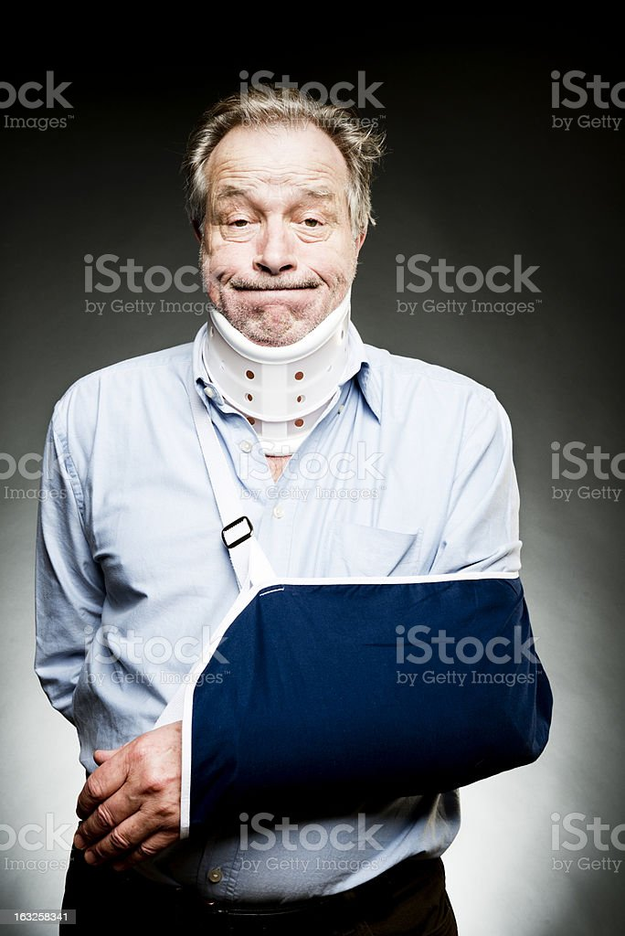 Mature Man With Whiplash With Neck Brace and Sling stock photo