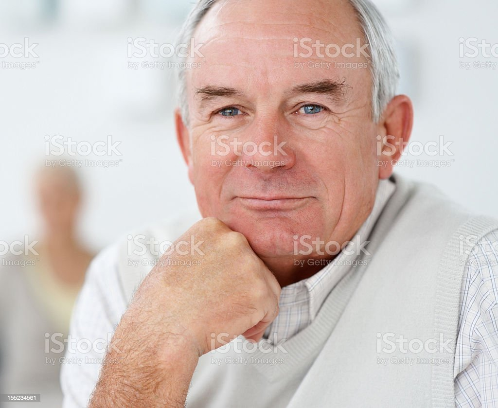 Mature man with wife in the background royalty-free stock photo
