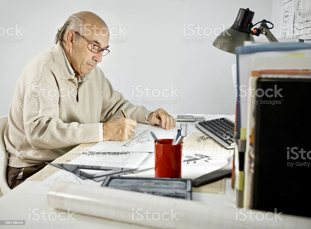 Mature Man Working at Desk royalty-free stock photo