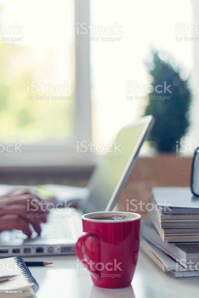 Mature man working from home stock photo