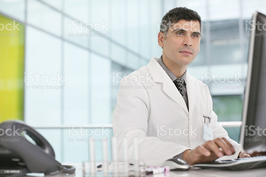 Mature man working on computer in laboratory royalty-free stock photo