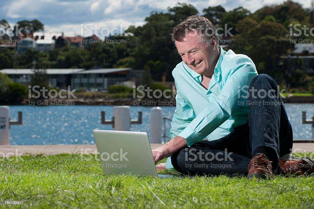 Mature Man working on laptop royalty-free stock photo