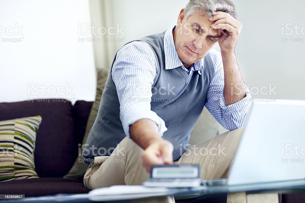 Mature man worried about paying his bills royalty-free stock photo