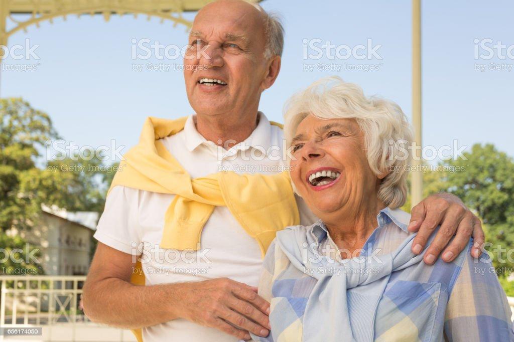 Mature marriage at park pergola stock photo