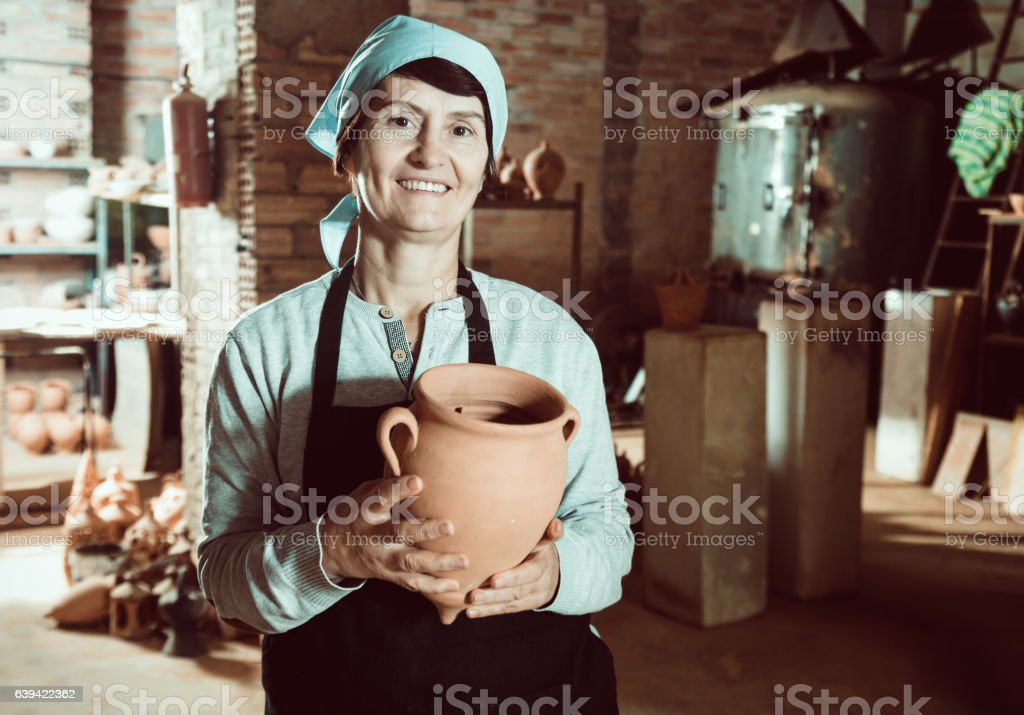 Mature master among the pottery at the workshop stock photo