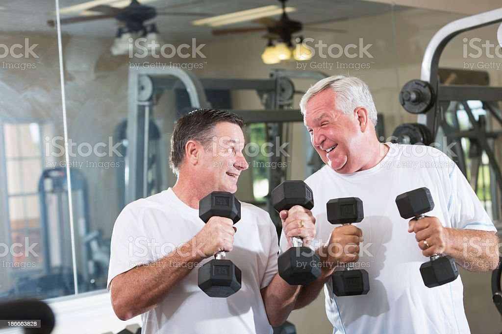 Mature men at the gym royalty-free stock photo