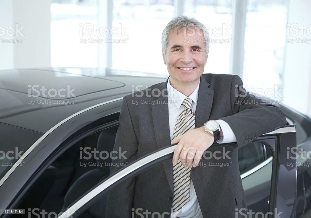 Mature men buying car. royalty-free stock photo