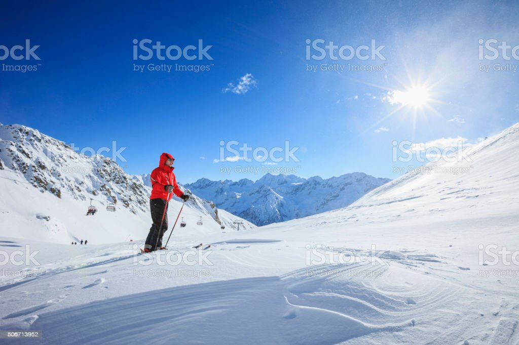 Mature men snow skier  Off piste skiing    Sunny ski resorts stock photo