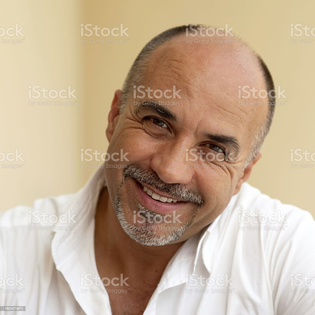 Mature middle age bald man smiling stock photo