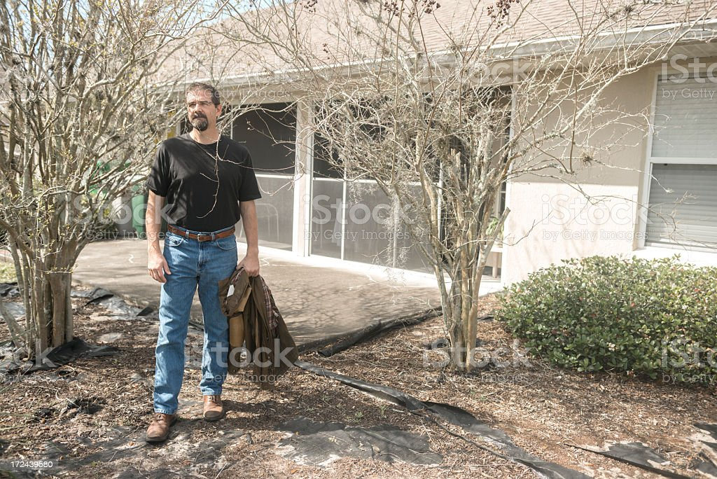 Mature Middle Aged American Man Standing in Home Backyard royalty-free stock photo