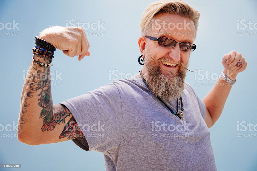 Mature modern man working out his muscles stock photo