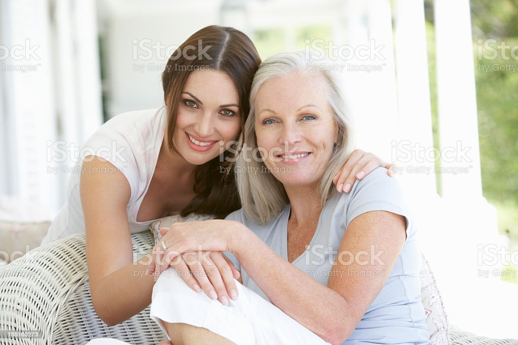 Mature Mother And Daughter Hugging stock photo