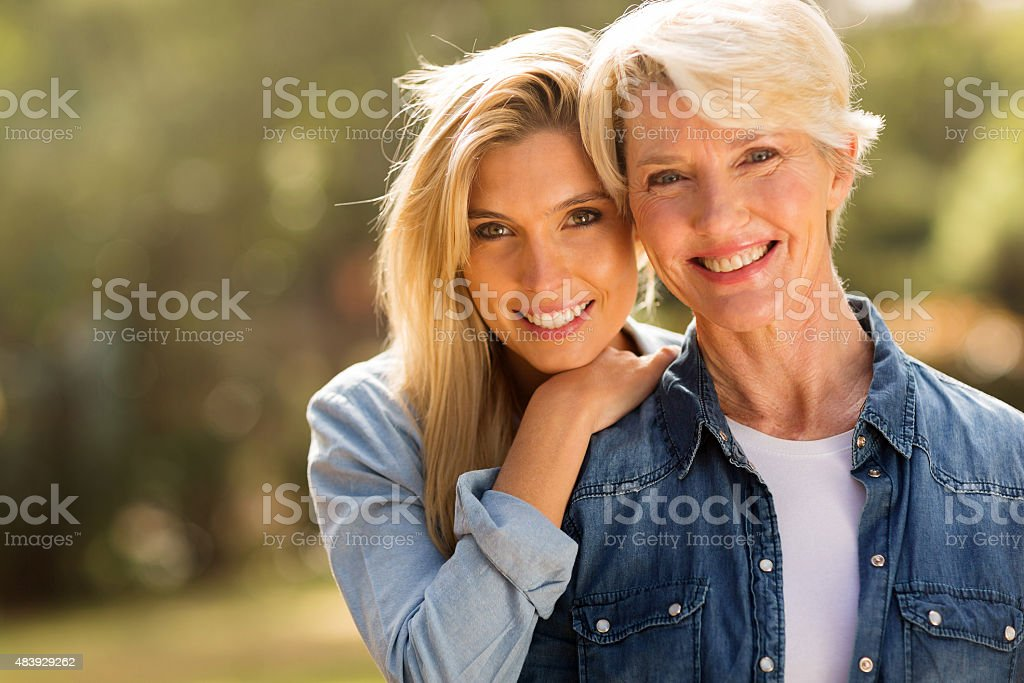mature mother and young daughter stock photo