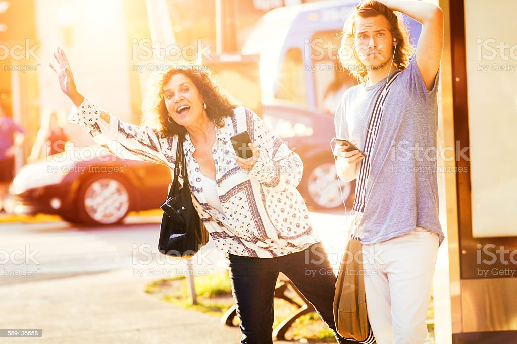Mature mother mistakes car pool for taxi stock photo