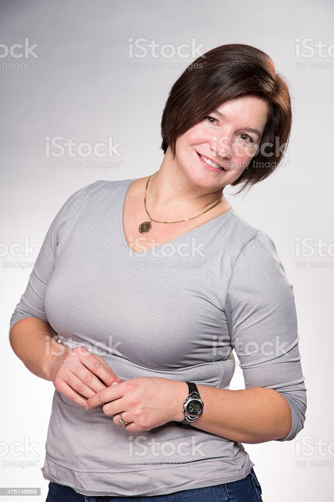 Mature mother portrait leaning and smiling stock photo