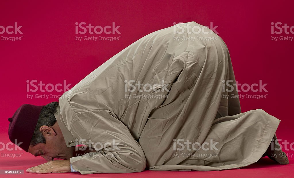 Mature muslim man praying stock photo