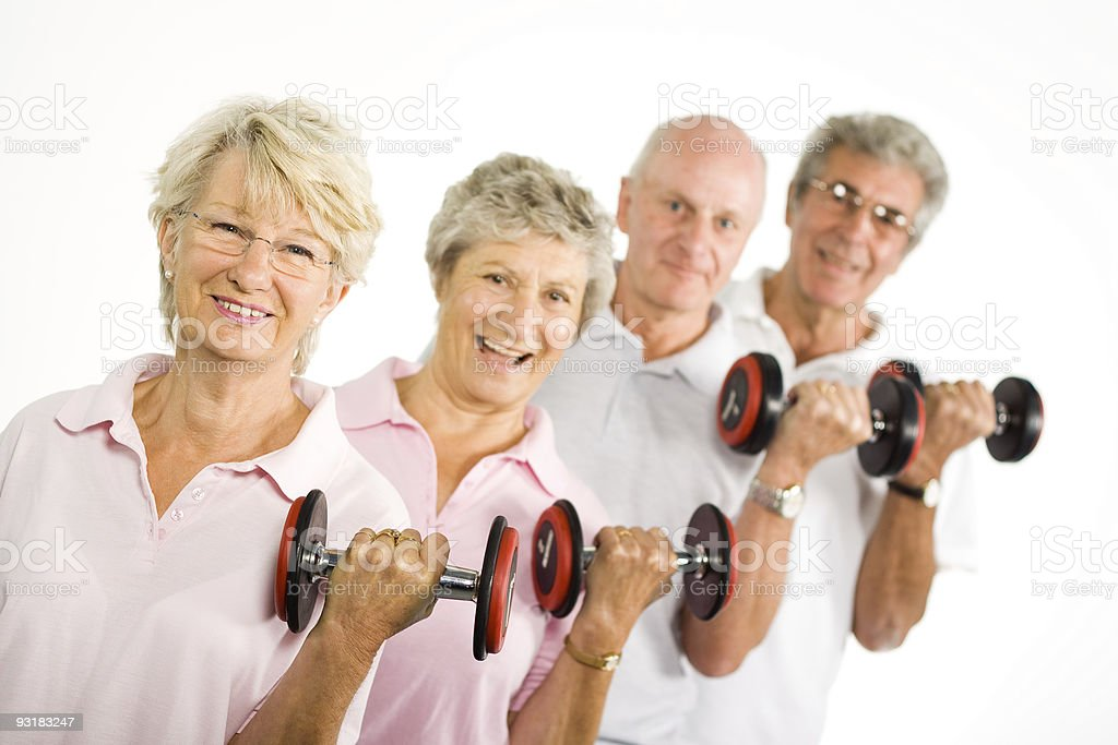 Mature older people lifting weights stock photo