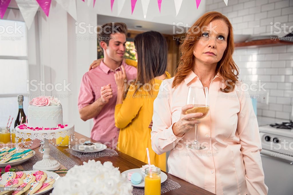 Mature older person party family event feeling left out fifth-wheel stock photo