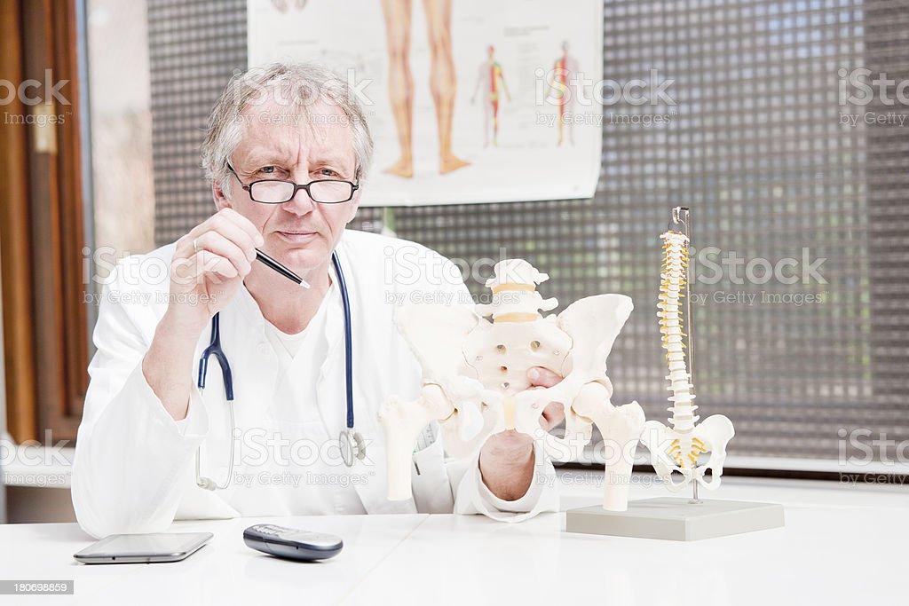 Mature orthopedist royalty-free stock photo